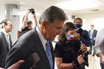 Sen. Joe Manchin, D-W.Va., talks with reporters as he walks to a vote on Capitol Hill, Tuesday, June 8, 2021, in Washington. (AP Photo/Alex Brandon)