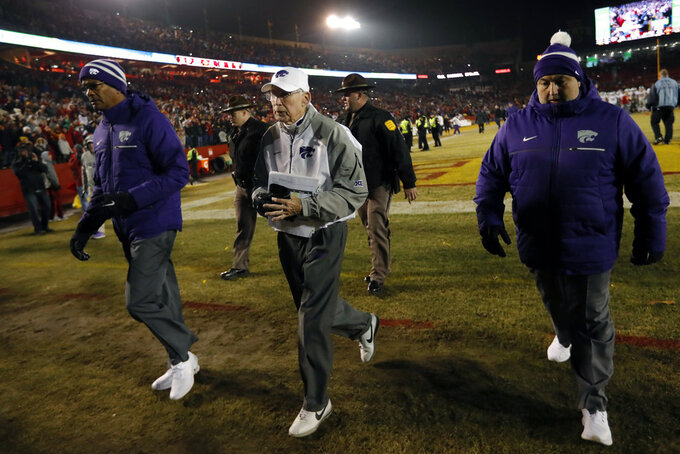 FILE - In this Nov. 24, 2018, file photo, Kansas State head coach Bill Snyder, center, walks off the field after an NCAA college football game against Iowa State, in Ames, Iowa. Kansas State has gone through the unenviable process of replacing a legend once before, and results were so disappointing that Bill Snyder came out of retirement to put the program back on track. Now, the Wildcats get a do-over. The 79-year-old Snyder announced in a statement Sunday, Dec. 2, 2018, he was retiring for a second and final time as the coach at Kansas State. (AP Photo/Charlie Neibergall, File)