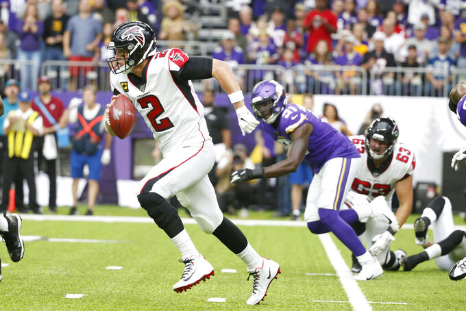 Atlanta Falcons quarterback Matt Ryan (2) scrambles up field during the first half of an NFL football game against the Minnesota Vikings, Sunday, Sept. 8, 2019, in Minneapolis. (AP Photo/Bruce Kluckhohn)