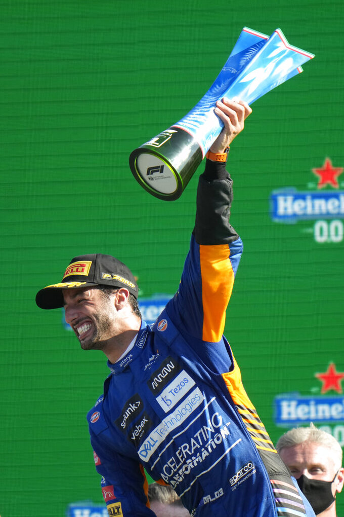 Mclaren driver Daniel Ricciardo of Australia celebrates after winning during the Italian Formula One Grand Prix, at Monza racetrack, in Monza, Italy, Sunday, Sept.12, 2021. (AP Photo/Luca Bruno)