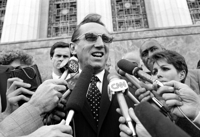 FILE - Los Angeles Raiders' owner Al Davis speaks to the media after a Federal Court jury ruled in favor of the team and the Los Angeles Coliseum in an antitrust suit against the National Football League, in Los Angeles, in this Wednesday, April 14, 1983, file photo. When director Ken Rodgers decided to do a documentary looking back on the battles between late Raiders owner Al Davis and late NFL commissioner Pete Rozelle he decided he wanted to tell the stories from their perspectives. (AP Photo/Nick Ut, File)