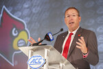 Louisville head coach Scott Satterfield answers a question during an NCAA college football news conference at the Atlantic Coast Conference media days in Charlotte, N.C., Thursday, July 22, 2021. (AP Photo/Nell Redmond)