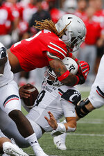Ohio State defensive end Chase Young, top, sacks Cincinnati quarterback Desmond Ridder during the first half of an NCAA college football game Saturday, Sept. 7, 2019, in Columbus, Ohio. (AP Photo/Jay LaPrete)