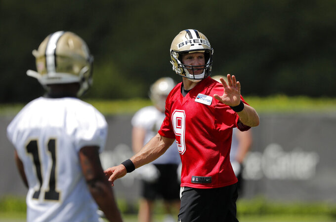 New Orleans Saints quarterback Drew Brees (9) works out with rookie wide receiver Deonte Harris during NFL football practice in Metairie, La., Thursday, May 23, 2019. (AP Photo/Gerald Herbert)