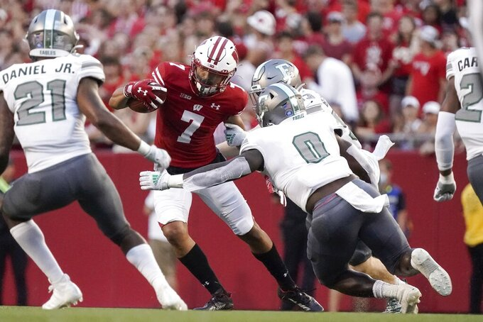 Wisconsin's Danny Davis III runs after a catch during the first half of an NCAA college football game against Eastern Michigan Saturday, Sept. 11, 2021, in Madison, Wis. (AP Photo/Morry Gash)