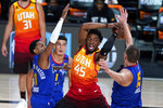 Utah Jazz's Donovan Mitchell (45) loses the ball as Denver Nuggets' Monte Morris (11) and Nikola Jokic (15) defend during the first half of an NBA basketball first round playoff game Sunday, Aug. 30, 2020, in Lake Buena Vista, Fla. (AP Photo/Ashley Landis)