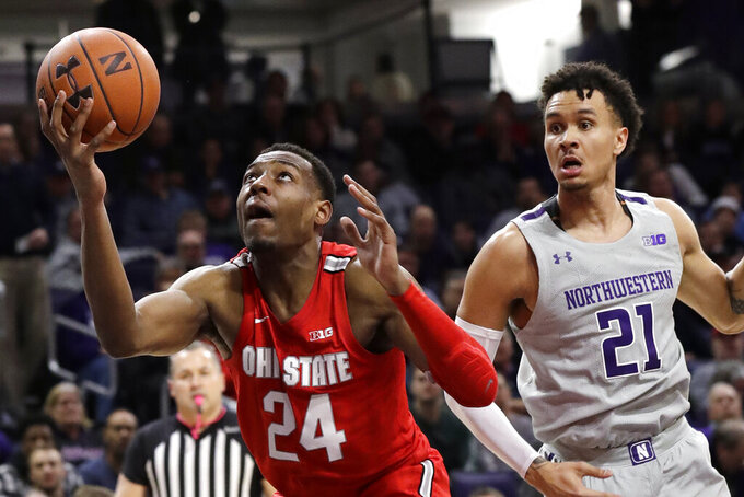 Ohio State forward Andre Wesson, front left, controls the ball against Northwestern forward A.J. Turner during the first half of an NCAA college basketball game in Evanston, Ill., Sunday, Jan. 26, 2020. (AP Photo/Nam Y. Huh)