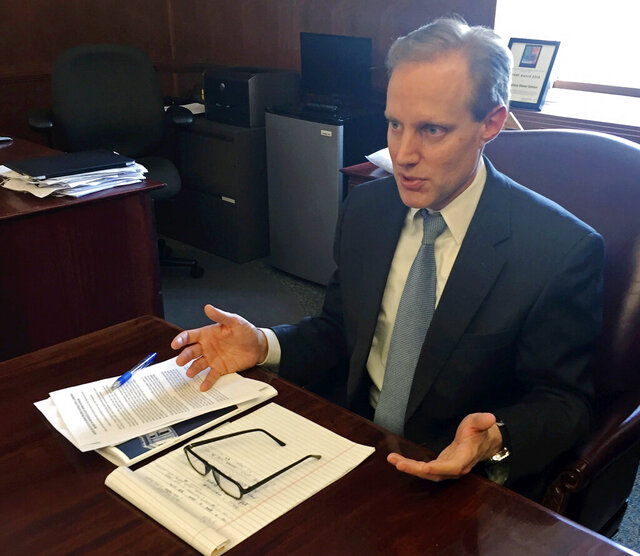 FILE - In this March 16, 2018 file photo, Minnesota Secretary of State Steve Simon discusses election security issues in his St. Paul, Minn. office. Minnesota will waive its witness requirements for absentee ballots for the statewide primary election in August under the settlement of two lawsuits sparked by the health threat from the coronavirus pandemic. The lawsuits were filed by political arms of the League of Women Voters of Minnesota and the Minnesota Alliance for Retired Americans. A Ramsey County judge signed off on the consent decree with the retirees Wednesday, June 17, 2020 while a federal judge scheduled a hearing for Thursday on the league's case. (AP Photo/Steve Karnowski,File)