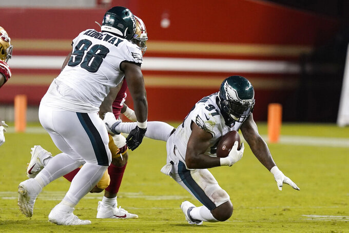 Philadelphia Eagles defensive tackle Malik Jackson (97) recovers a fumble against the San Francisco 49ers during the second half of an NFL football game in Santa Clara, Calif., Sunday, Oct. 4, 2020. (AP Photo/Tony Avelar)