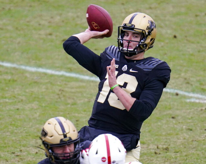 FILE - In this Dec. 5, 2020, file photo, Purdue quarterback Jack Plummer (13) throws against Nebraska during the first quarter of an NCAA college football game in West Lafayette, Ind. Plummer finished second in each of Purdue's last two summer quarterback competitions. (AP Photo/Michael Conroy, File)
