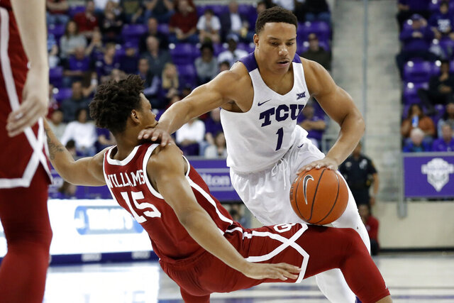 Oklahoma guard Alondes Williams (15) is knocked backwards defending against a drive to the basket by TCU guard Desmond Bane (1) in the second half of an NCAA college basketball game in Fort Worth, Texas, Saturday, March 7, 2020. (AP Photo/Tony Gutierrez)