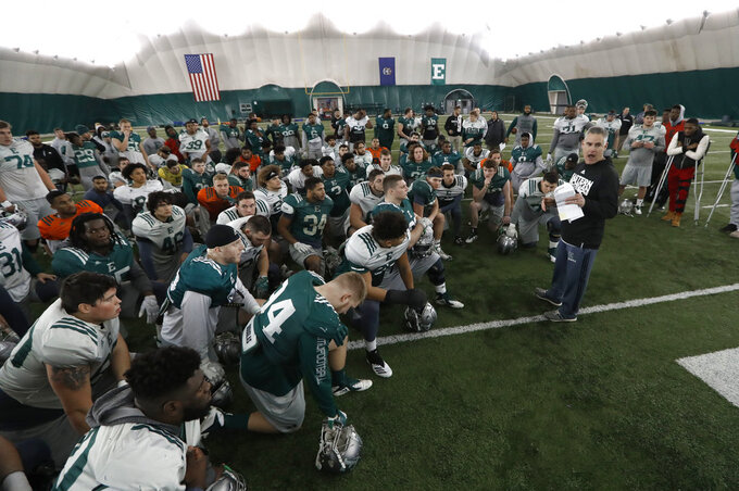 Eastern Michigan football coach Chris Creighton talks to the team during practice in Ypsilanti, Mich., Monday, Dec. 10, 2018. Eastern Michigan's football team has stepped out of the shadows created by the neighboring University of Michigan and four professional teams just down the road in the Motor City. The Eagles will face Georgia Southern in the Camellia Bowl on Saturday, earning a spot in postseason play for the second time in three years and just the third time in school history. (AP Photo/Paul Sancya)