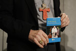 Cardinal Michael Czerny holds a copy of the post-synodal apostolic exhortation