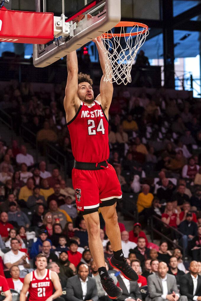 North Carolina State guard Devon Daniels (24) attempts a dunk in the second half of an NCAA college basketball game against Georgia Tech Saturday, Jan. 25, 2020, in Atlanta. Georgia Tech won 64-58. (AP Photo/Danny Karnik)