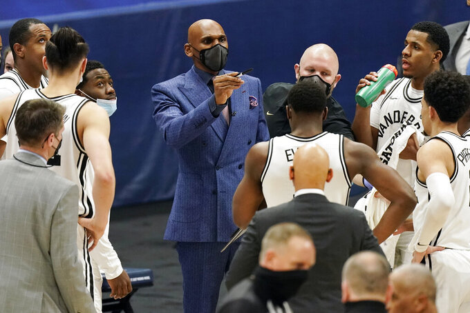 Vanderbilt head coach Jerry Stackhouse talks with his team in the second half of an NCAA college basketball game against Texas A&M in the Southeastern Conference Tournament Wednesday, March 10, 2021, in Nashville, Tenn. (AP Photo/Mark Humphrey)