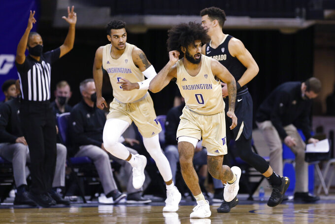Washington's Marcus Tsohonis (0) reacts after making a 3-pointer against Colorado during the first half of an NCAA college basketball game Wednesday, Jan. 20, 2021, in Seattle. (AP Photo/Joe Nicholson)