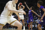 California guard Matt Bradley (20) hits the winning basket in overtime against Washington forward Jaden McDaniels (0) during the second half of an NCAA college basketball game in Berkeley, Calif., Saturday, Jan. 11, 2020. (AP Photo/Jed Jacobsohn)