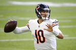 FILE - Chicago Bears quarterback Mitchell Trubisky throws a pass during an NFL football game against the Minnesota Vikings in Minneapolis, in this Sunday, Dec. 20, 2020, file photo.  The Buffalo Bills agreed to sign former Chicago Bears starter Mitch Trubisky to a one-year contract on Thursday, March 18, 2021, and serve as Josh Allen's primary backup.(AP Photo/Bruce Kluckhohn, File)