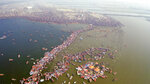 This image released by National Geographic shows a large crowd swimming in the water during a Hindu festival in India, shown in the two-part special
