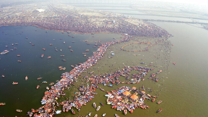 """This image released by National Geographic shows a large crowd swimming in the water during a Hindu festival in India, shown in the two-part special """"India from Above,"""" narrated by actor Dev Patel. (Gaurav Agarwal/National Geographic via AP)"""