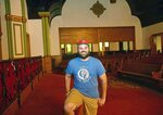 Dave Yargeau, real estate developer for the Mon Valley Initiative, poses for a portrait inside the old First United Presbyterian Church Thursday, July 22, 2021, in Braddock. (Pittsburgh Post-Gazette via AP)