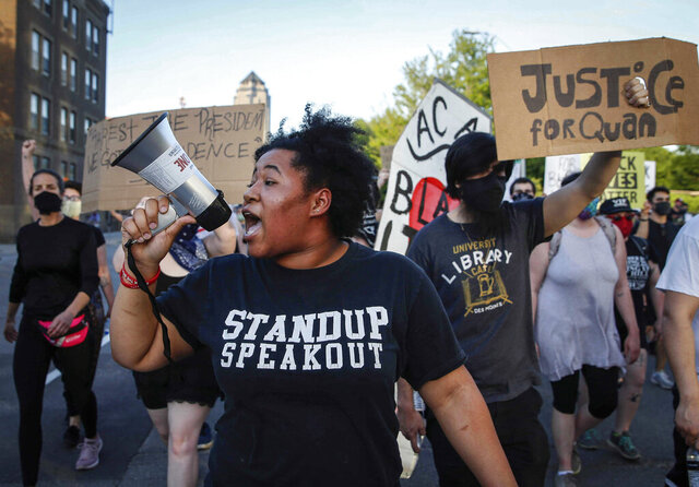 Protesters march to the governor's mansion in Des Moines, Iowa, Tuesday, June 2, 2020. (Bryon Houlgrave/The Des Moines Register via AP)