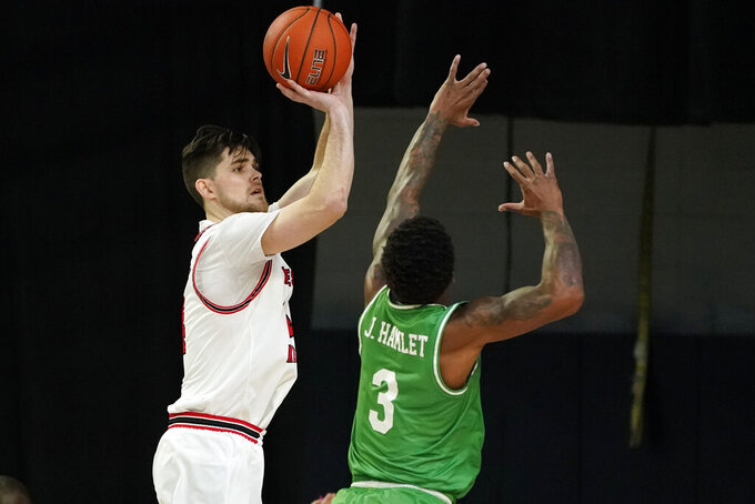 Western Kentucky guard Luke Frampton shoots over North Texas guard Javion Hamlet (3) during the first half of the championship game in the NCAA Conference USA men's basketball tournament Saturday, March 13, 2021, in Frisco, Texas. (AP Photo/Tony Gutierrez)