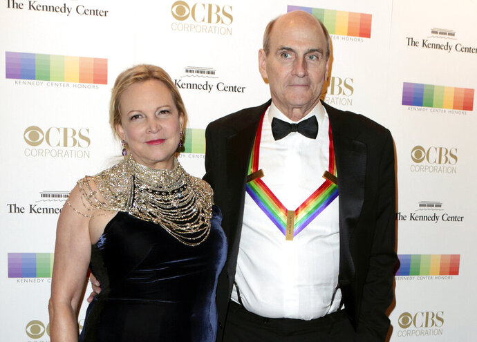 FILE - In this Dec. 4, 2016 file photo, Kim Taylor, left, and her husband James Taylor appear at the 39th Annual Kennedy Center Honors in Washington, D.C. The couple have donated $1 million to Massachusetts General Hospital in Boston to help with its battle against the spread of the new coronavirus. The gift, announced Tuesday, March 24, 2020, will help the hospital direct resources where the need is greatest, the hospital said in a statement. (Photo by Owen Sweeney/Invision/AP, File)