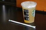 FILE - In this March 18, 2015, file photo, a Starbucks iced drink with a