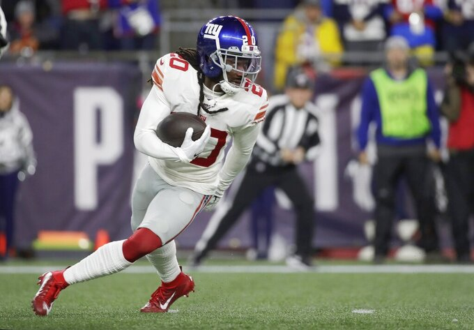 New York Giants cornerback Janoris Jenkins runs with the ball after intercepting a pass intended for New England Patriots wide receiver Julian Edelman in the first half of an NFL football game, Thursday, Oct. 10, 2019, in Foxborough, Mass. (AP Photo/Elise Amendola)