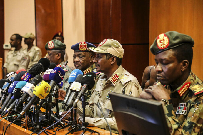 FILE - In this April 30, 2019 file photo, Gen. Mohamed Hamdan Dagalo, the deputy head of the military council, second right, speaks at a press conference in Khartoum, Sudan. Sudan's ruling military council is meeting with protesters on Sunday, May19, 2019, to discuss the country's political transition after talks were halted for three days while roads were cleared outside the main sit-in in the capital, Khartoum. (AP Photo)