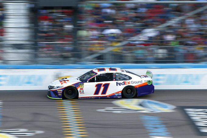 Denny Hamlin drives during the NASCAR Cup Series auto race at ISM Raceway, Sunday, Nov. 10, 2019, in Avondale, Ariz. (AP Photo/Ralph Freso)