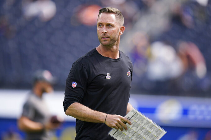 FILE - In this Oct. 3, 2021, file photo, Arizona Cardinals coach Kliff Kingsbury walks on the field before the team's NFL football game against the Los Angeles Rams in Inglewood, Calif. Kingsbury and an assistant coach and a player will miss the Cardinals' game Sunday at Cleveland after testing positive for COVID-19. (AP Photo/Jae C. Hong, File)