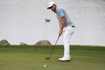 Andrew Landry watches his birdie putt fall in the 18th hole during the final round to win The American Express golf tournament on the Stadium Course at PGA West in La Quinta, Calif., Sunday, Jan. 19, 2020. (AP Photo/Alex Gallardo)