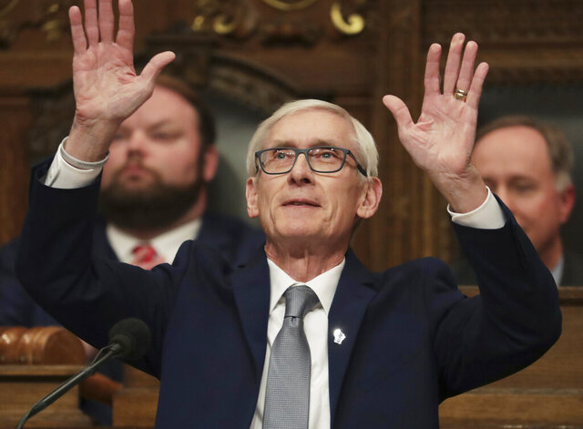 Wisconsin Gov. Tony Evers waves to his family as he gets ready to deliver his State of the State address in the Assembly Chambers at the Wisconsin state Capitol in Madison, Wis., Wednesday, Jan. 22, 2020. (Amber Arnold/Wisconsin State Journal via AP)