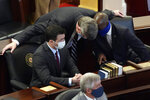 FILE - In this Jan. 13, 2021 file photo, Sen. Mike Woodard, D-Durham, speaks with Sen. Ben Clark, D-Hoke, right, and Sen. Jeff Jackson, D-Mecklenburg in the Senate chamber during the opening session of the North Carolina General Assembly in Raleigh, N.C.    Jackson has announced he's running for the U.S. Senate in 2022.  Jackson unveiled his bid on Tuesday, Jan, 26, 2021. He's the second Democrat to enter the race to succeed Republican Sen. Richard Burr, who isn't seeking reelection.(AP Photo/Gerry Broome, File)