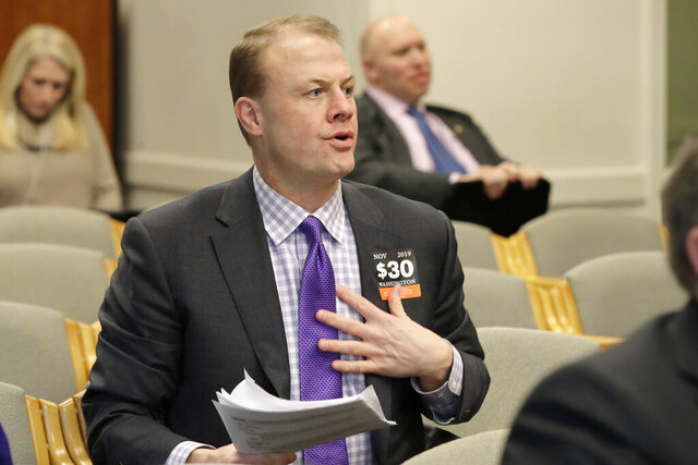 FILE - In this Feb. 4, 2020, file photo, initiative promoter Tim Eyman waits to speak during a hearing before the Washington State Senate Transportation Committee at the Capitol in Olympia, Wash. A judge has ruled that Eyman illegally failed to report more than $766,000 in campaign contributions over a six-year period. Thurston County Superior Court Judge James Dixon issued his ruling Friday, Feb. 21, 2020, in a lawsuit brought against Eyman by Washington Attorney General Bob Ferguson. (AP Photo/Ted S. Warren, File)