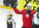 Fabrice Hercog of Switzerland celebrates goal during the Ice Hockey World Championship quaterfinal match between Switzerland and Germany at the Olympic Sports Center in Riga, Latvia, Thursday, June 3, 2021. (AP Photo/Oksana Dzadan)