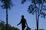 Dustin Johnson, of the United States, walks along the third fairway during the third round of the US Open Golf Championship, Saturday, Sept. 19, 2020, in Mamaroneck, N.Y. (AP Photo/John Minchillo)