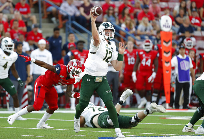 Colorado State quarterback Patrick O'Brien (12) passes past Fresno State linebacker Mykal Walker (3) during the first half of an NCAA college football game in Fresno, Calif., Saturday, Oct. 26 2019. (AP Photo/Gary Kazanjian)