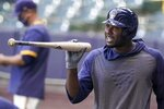 Milwaukee Brewers' Lorenzo Cain bats during a practice session Saturday, July 4, 2020, at Miller Park in Milwaukee. (AP Photo/Morry Gash)