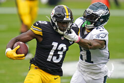 Pittsburgh Steelers wide receiver James Washington (13) is tackled by Philadelphia Eagles strong safety Jalen Mills (21) during the first half of an NFL football game, Sunday, Oct. 11, 2020, in Pittsburgh. (AP Photo/Keith Srakocic)