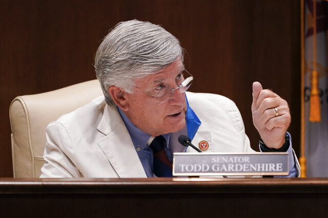 Sen. Todd Gardenhire, R-Chattanooga, asks a question during a meeting of the Senate Judiciary Committee, Tuesday, Aug. 11, 2020, in Nashville, Tenn. The special session was called by Tennessee Gov. Bill Lee to pass liability reforms to protect businesses from lawsuits prompted by reopening after the coronavirus quarantine. (AP Photo/Mark Humphrey)