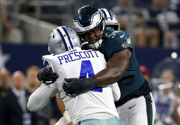 Dallas Cowboys quarterback Dak Prescott (4) is sacked by Philadelphia Eagles defensive tackle Hassan Ridgeway (98) in the second half of an NFL football game in Arlington, Texas, Sunday, Oct. 20, 2019. (AP Photo/Michael Ainsworth)