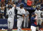 New York Yankees' Gary Sanchez, center, celebrates with Brett Gardner after hitting a three-run home run against the Tampa Bay Rays during the 10th inning of a baseball game Thursday, July 4, 2019, in St. Petersburg, Fla. (AP Photo/Scott Audette)