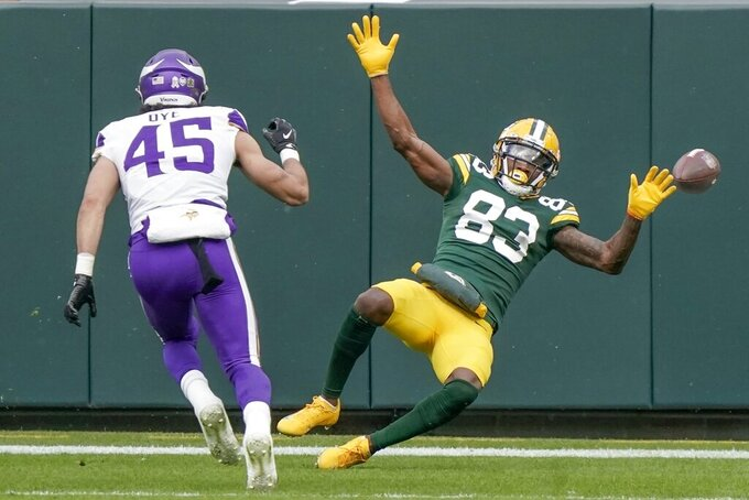 Green Bay Packers' Marquez Valdes-Scantling falls in front of Minnesota Vikings' Troy Dye during the first half of an NFL football game Sunday, Nov. 1, 2020, in Green Bay, Wis. Pass interference was called on the play. (AP Photo/Morry Gash)