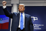 President Donald Trump holds up his fist as he finishes his speech at the Republican Jewish Coalition's annual leadership meeting, Saturday April 6, 2019, in Las Vegas. (AP Photo/Jacquelyn Martin)