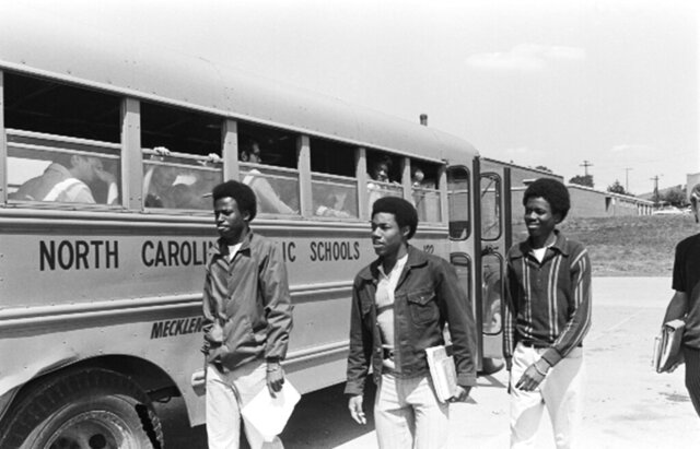 FILE - In this May 15, 1972, file photo, unidentified students of West Charlotte High School leave a bus in Charlotte, W.Va. A man whose challenge to the notion of segregated public schools helped spark the use of busing to integrate schools has died at his Virginia home. The Rev. Darius L. Swann was 95. Swann's wife, Vera, said her husband died on March 8, 2020, of pneumonia. (AP Photo/Harold L. Valentine, File)