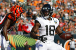 "FILE - In this Oct. 20, 2019, file file photo, Jacksonville Jaguars wide receiver Chris Conley (18) scores a 2-point conversation in the second half of the team's NFL football game against the Cincinnati Bengals in Cincinnati. Conley called on ""figures who are the face of the league"" to do more to help fight social injustice. The sixth-year pro made it clear Thursday, Aug. 27, he was talking about the NFL's top quarterbacks, the ones who have the most influence in games, in locker rooms and in communities. Think Tom Brady, Drew Brees, Patrick Mahomes, Deshaun Watson, Russell Wilson and Lamar Jackson, for starters. (AP Photo/Frank Victores, File)"