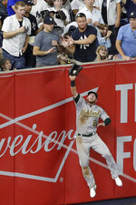 Oakland Athletics left fielder Robbie Grossman catches a ball hit by New York Yankees' Gleyber Torres during the fifth inning of a baseball game Friday, Aug. 30, 2019, in New York. (AP Photo/Frank Franklin II)